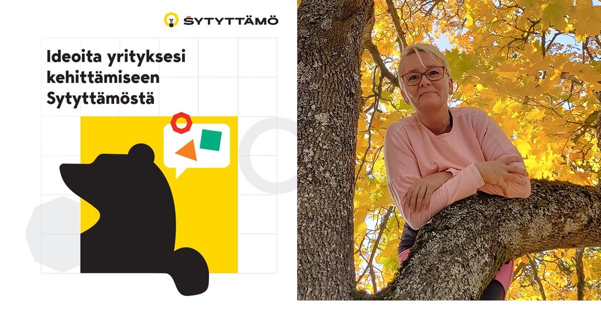Sytyttämön karhuvinjetti ja Elina Rautanen nojaamassa syksyiseen vaahteraan.